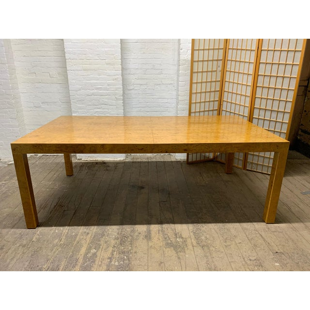 Milo Baughman burl wood parson / dining table with two extension leaves. Table also has two hidden legs underneath which...