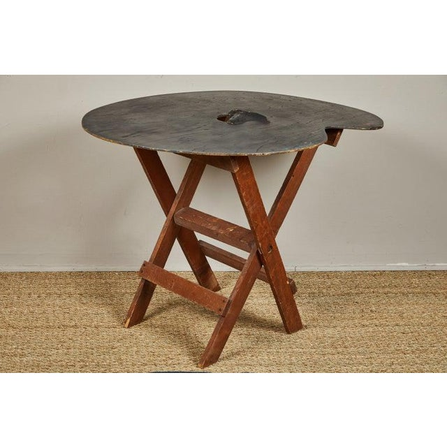 Oversized painter's palette reconfigured into a quirky table.