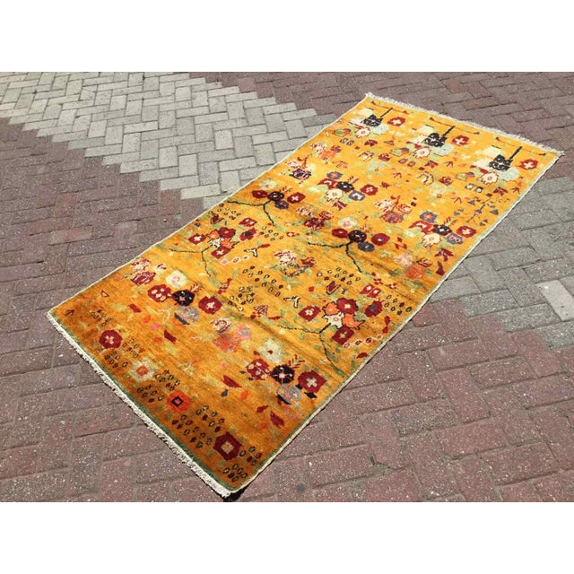 This gorgeous Hand knotted Vintage Anatolian area rug is approximately 60 years old in excellent vintage condition. The...