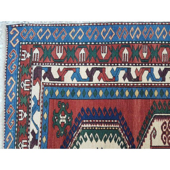 This is a vintage handwoven wool rug from Turkey. The piece was made in the 1970s.