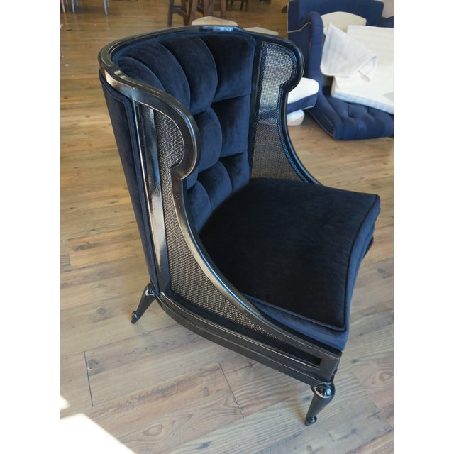 Ebonized finish on this stylish wingback. I love the legs along with the concave front. Beautiful Black Velvet on a...