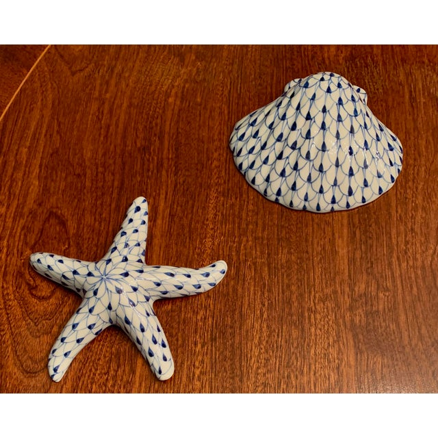 Whimsical beach accessories in traditional blue and white fishnet pattern. This set is hand painted and can also be hung...