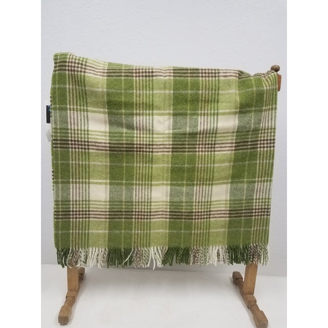 Merino Wool Throw Greens Brown and White Plaid - Made in England A versatile throw in a plaid design made from soft 100%...