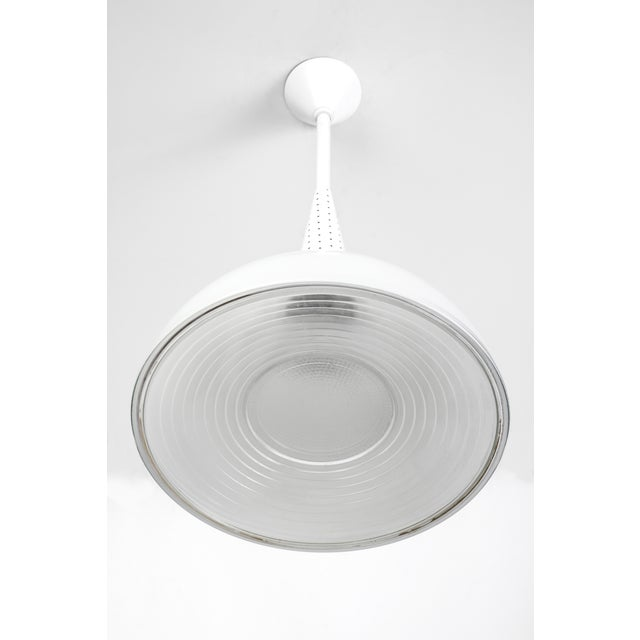 This unique pendant light was design by Mathieu Mategot. Features an enameled metal frame with perforated sleeve and...