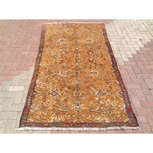 This gorgeous hand knotted vintage Anatolian area rug is approximately 70 years old and in excellent vintage condition....