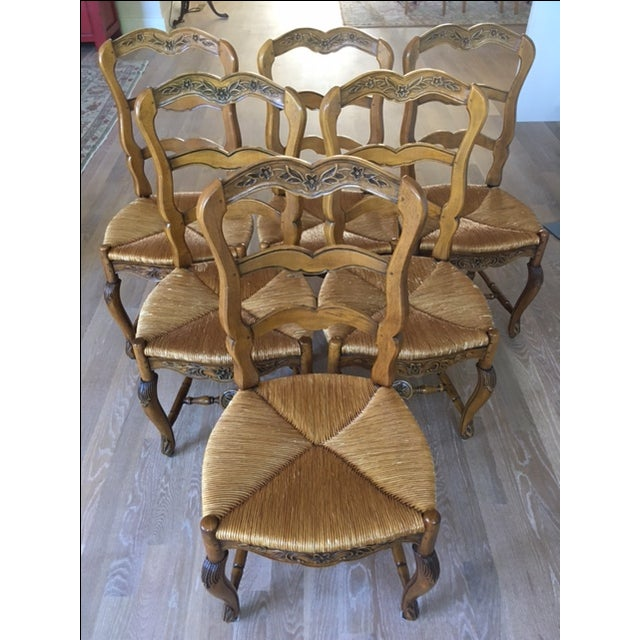 Six very high quality, hand carved French county Pierre Deux dining chairs, no longer available. Light colored stained...