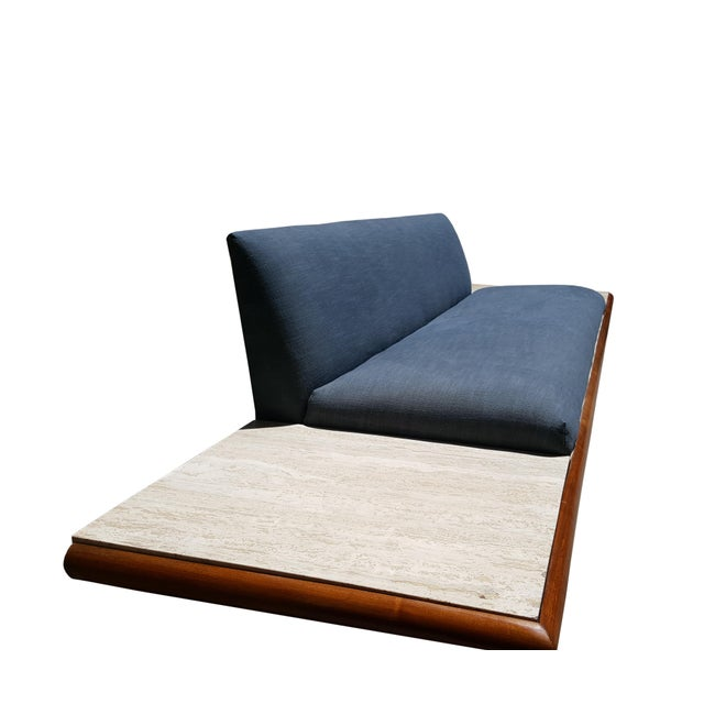 An Adrian Pearsall sofa by craft associates Walnut boomerang shape. Travertine end table integrated with the structure...