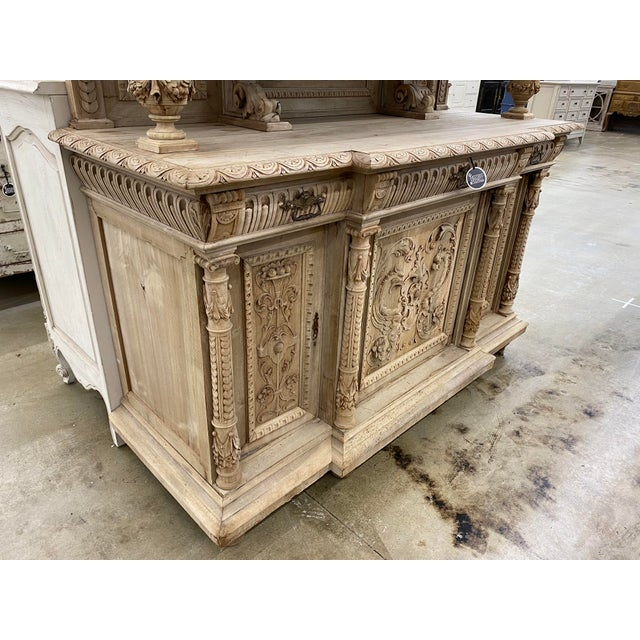 French Renaissance Revival heavily carved bleached walnut sideboard, mid 19th century, pierced and carved crest of floral...
