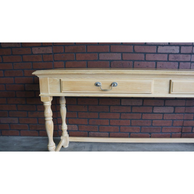 Country cottage and French farmhouse come to mind with this console table by Drexel Heritage. Vintage style is apparent...