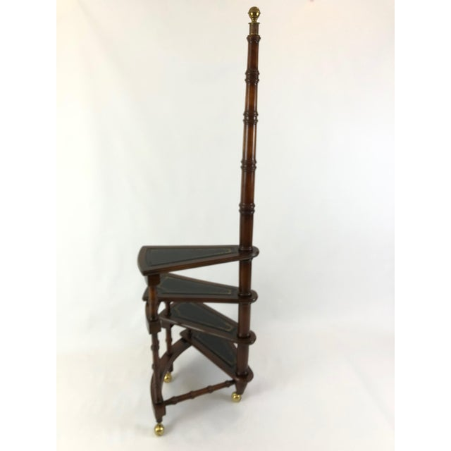 Beautiful sculptural mahogany library steps having black leather embossed with gold on the steps, handsome brass finial...
