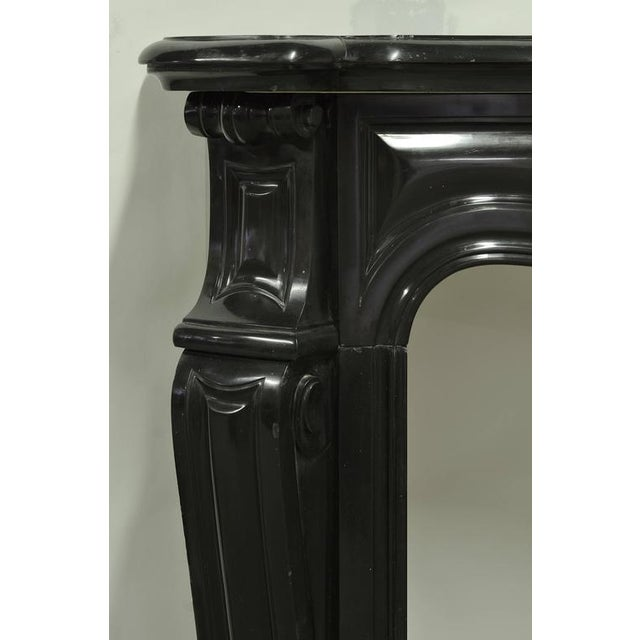 Elegant pair of 19th century black marble Pompadour style mantel pieces. Measures: Top: Height 42.12 in. (107 cm), width...
