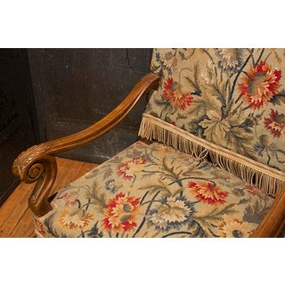 French Needlepoint Begere Chair With Nail Head Trim and Fringe Accent. Preview
