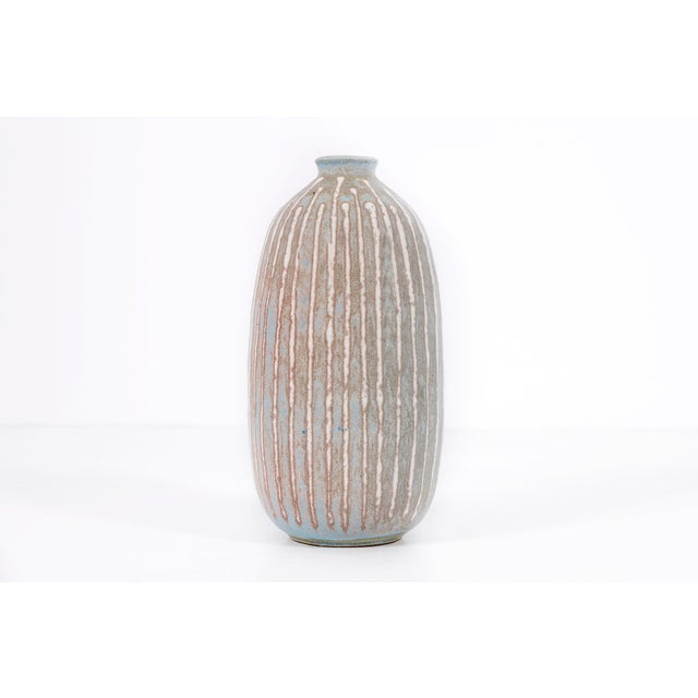 Clyde Burt ceramic vase in glazed stoneware with incised, abstract details. Signed to underside: [CB]. American, circa 1965.