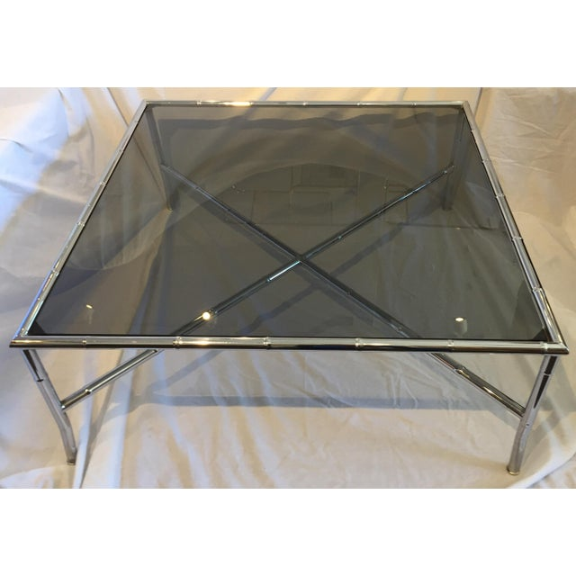 Milo Baughman Style Faux bamboo chrome and antiqued glass table with classic X-base. This would fit in with any Hollywood...