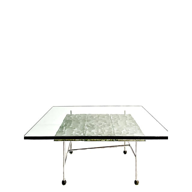 One-of-a-kind studio-crafted square cocktail table from Donald Drumm. 1960's. Cast aluminum, steel and glass. Rare and in...