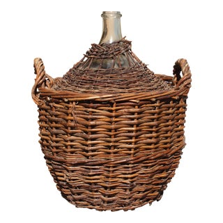 Monumental French Clear Glass Demijohn Bottle in Woven Grape Vine Basket.