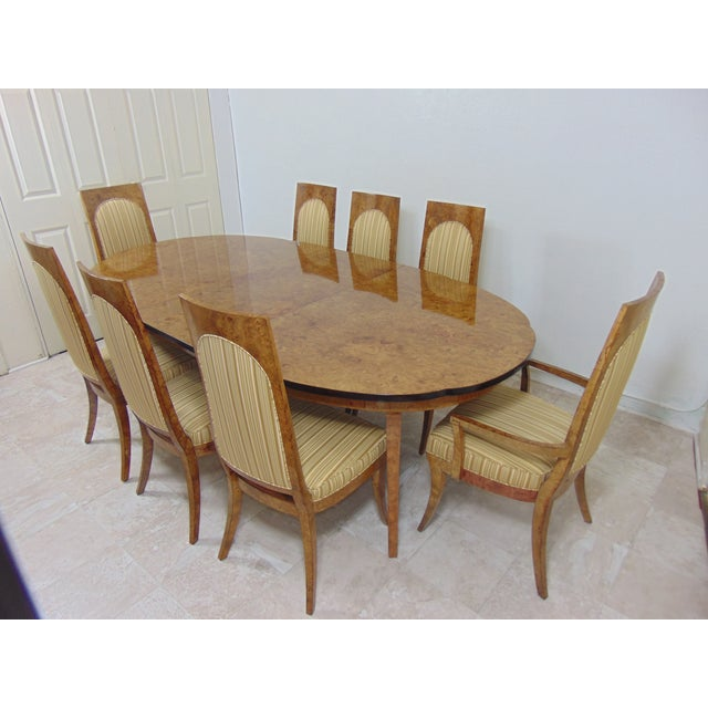 This is a gorgeous dining set, the Elm burl veneer makes it very attractive. 8 chairs. It's been restored professionally,...