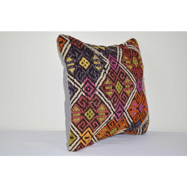 "These beautiful 14"" x 14"" pillow covers were made from an authentic, vintage Turkish rug handwoven in the 1960s. Bright..."