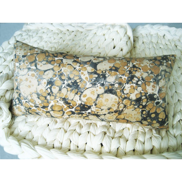 Pillow with Jonathan Adler designed fabric. Damask texture. Down-like fill. Same fabric front and back. Knife edge seams....