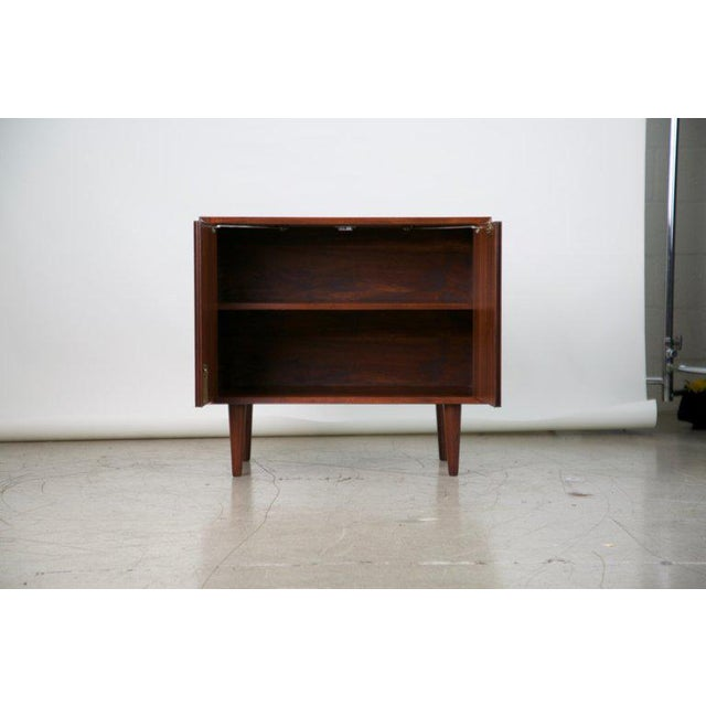 An adorable yet highly functional cabinet that can be locked to house your valuable or confidential items. This Mid-...