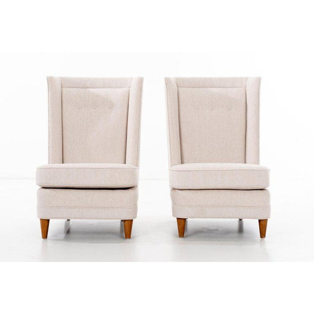 Laszlo for Brown & Saltman of California, pair of lounges. High-back curved sides with button tufted back padding. Solid...