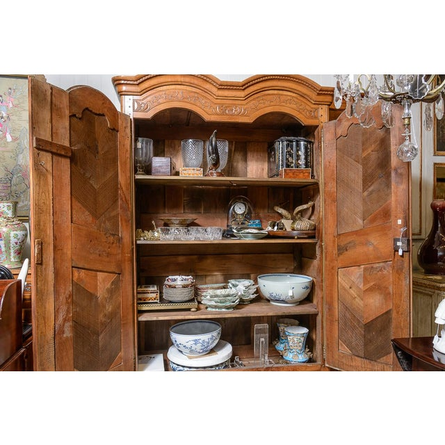 French, cherry, double dome armoire with elaborately carved doors and original hardware