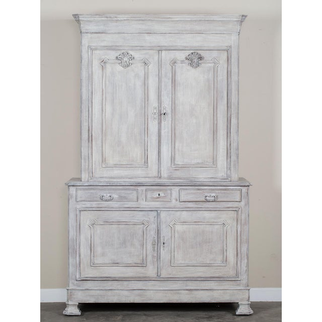 The handsome neoclassical lines of this antique French tall buffet cabinet circa 1850 is notable for the restrained...