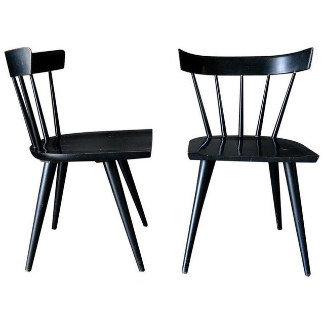 Pair of Paul McCobb Planner Group spindle back chairs in their original maple with black finish, circa 1955. Original...