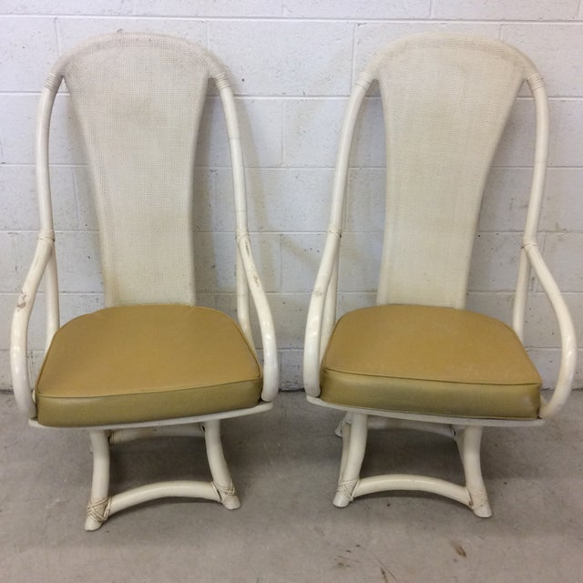 These were part of a dining set as the two captains chairs. Great funky style and very comfortable. Great condition, with...