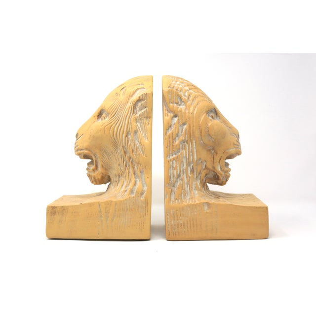 A spectacular, heavy pair of carved lion head bookends. Good vintage condition; minor crackling of the surface on one -...