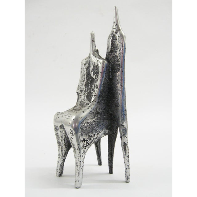The two abstracted figures in this cast aluminum piece by Israeli sculptor Aharon Bezalel b.1926 are very evocative. One...