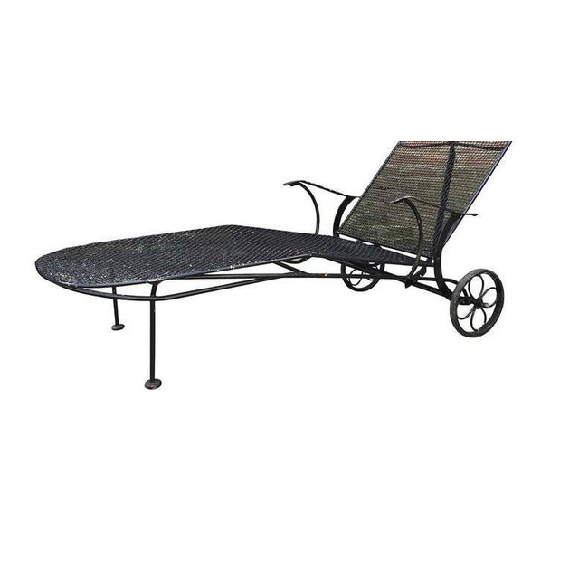 """Black """"Sculptura"""" iron mesh Outdoor/Patio chaise longue, produced circa 1950 by the Woodard Furniture Company. This..."""