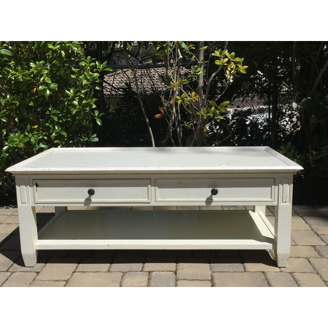 This is a rustic pottery barn coffee table. It has two drawers which are perfect for storing remote controls, board games,...