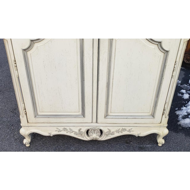 This is a very good French provincial style painted white double door bedroom armoire made by Century Furniture, c1990s....