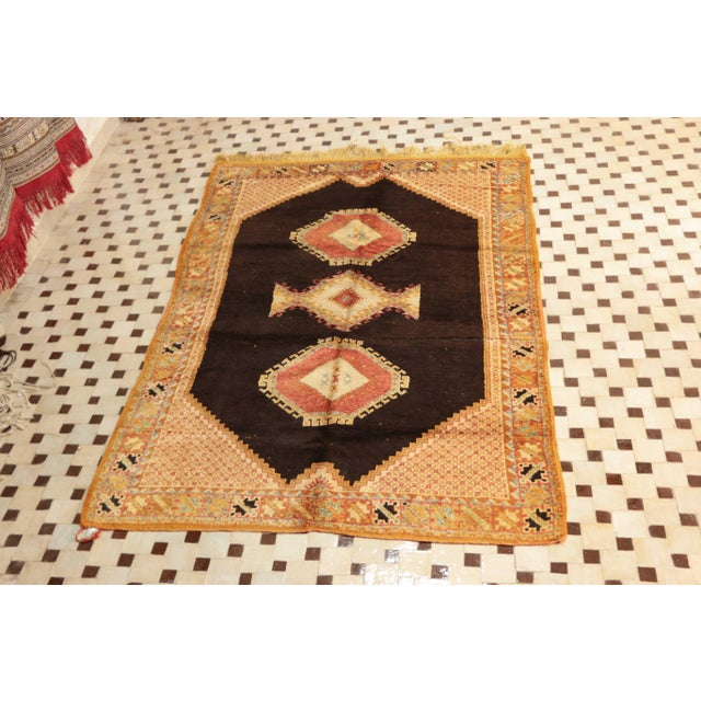 """Type of Rug: Ait Ouaghrda Size: 5'5"""" x 7'10"""" feet / 165 x 240 cm Material: 100% Wool Age: Vintage / circa 1970s Country of..."""