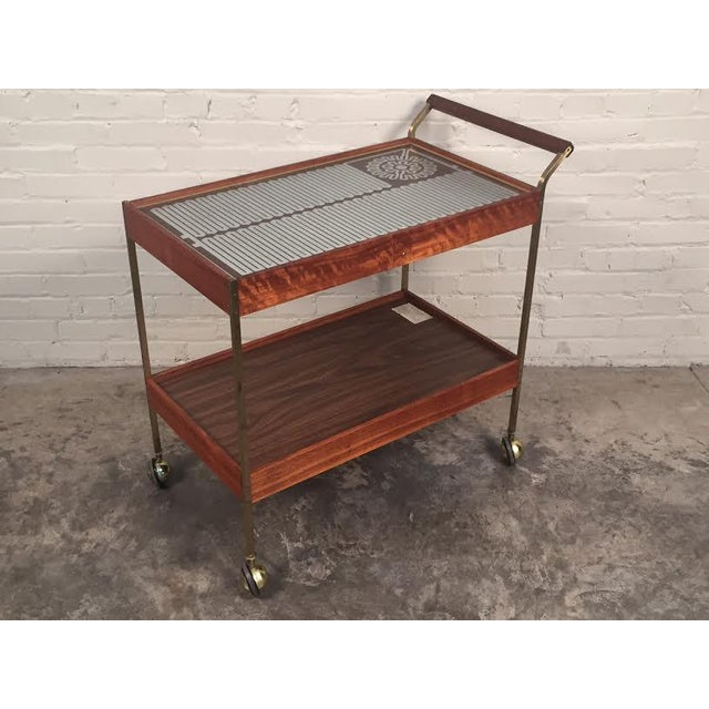Super cool Mid Century Modern buffet cart in working condition by Salton. Known for their trays for keeping food hot, this...