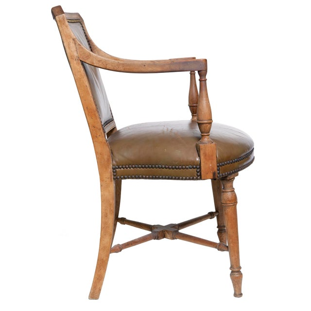 Neo classical/traditional style French walnut chair by Baker Furniture, original leather upholstery and brass nail heads....