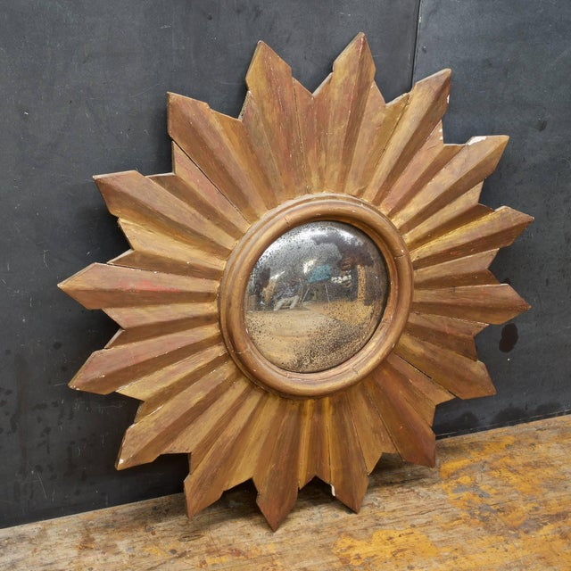 Rather large at almost 3 feet in diameter. A heavily Patinated and worn wall mirror, ready to hang, Revival design...