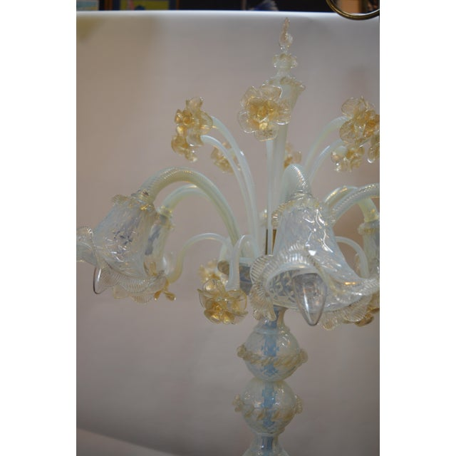 Murano floor lamp with opaline glass color and details in gold flakes.