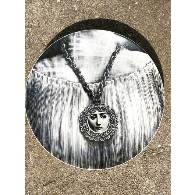 Vintage Piero Fornasetti Italian plate. Ceramic, featuring a woman's neck wearing a necklace with a woman's face. Iconic,...