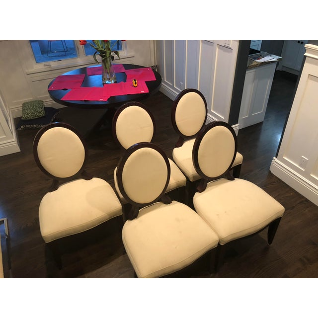 A beautiful set of oval X-back dining chairs by Barbara Barry for Baker Furniture. These chairs are a very classic and...