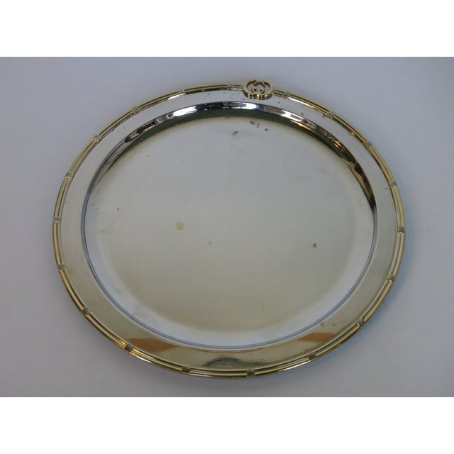 """Vintage Gucci round silver plate tray with brass edge. Signed Gucci made in Italy. Measure: It is 14.5"""" x 15"""" x .75""""..."""