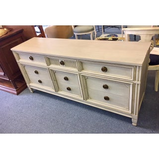 Gray Lowboy Dresser With Circular Brass Pulls Preview