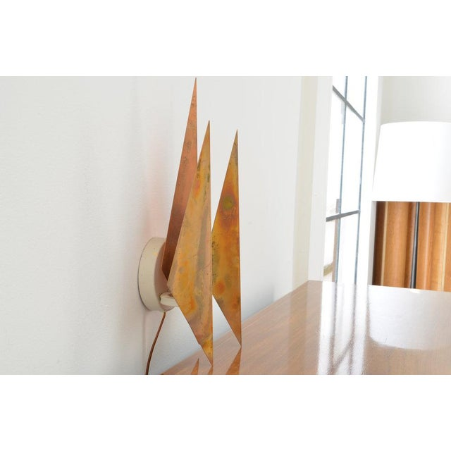 Vintage 1960s wall lamp by Svend Aage Holm Sørensen. Composed of three patinated copper shades. Manufactured and marked by...