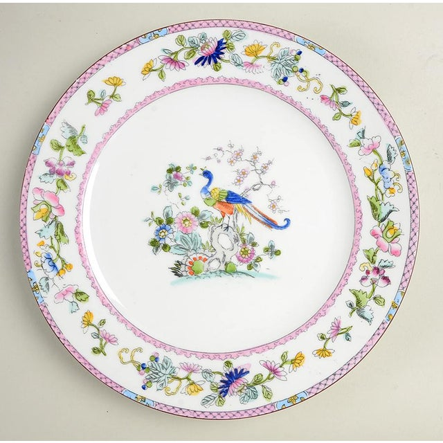 Noritake Pink with Bird of Paradise (N1397) Dinner Plate Set of 10 features multicolor floral rim with pretty pink accent...