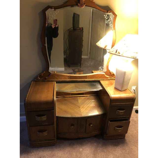 Good vintage condition. Miri is etch and beveled.Brass pulls with amazing detail. Two glass levels. Plenty room with four...