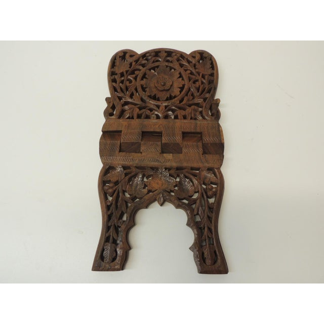 Folding Indian hand carved book display or stand. Size: 13 x 8 x 8 H.