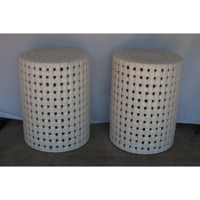 Pair of beautiful white ceramic garden stools/accent tables with unique basketweave design. Tops have intricate pattern...