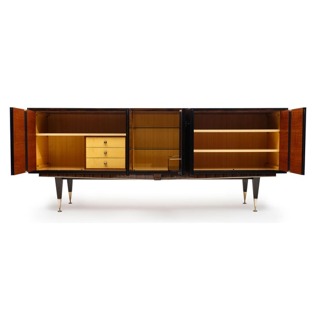 Macassar of Ebony French vintage buffet with a very elegant parqueted inlay on the front doors. The doors open to a satin...