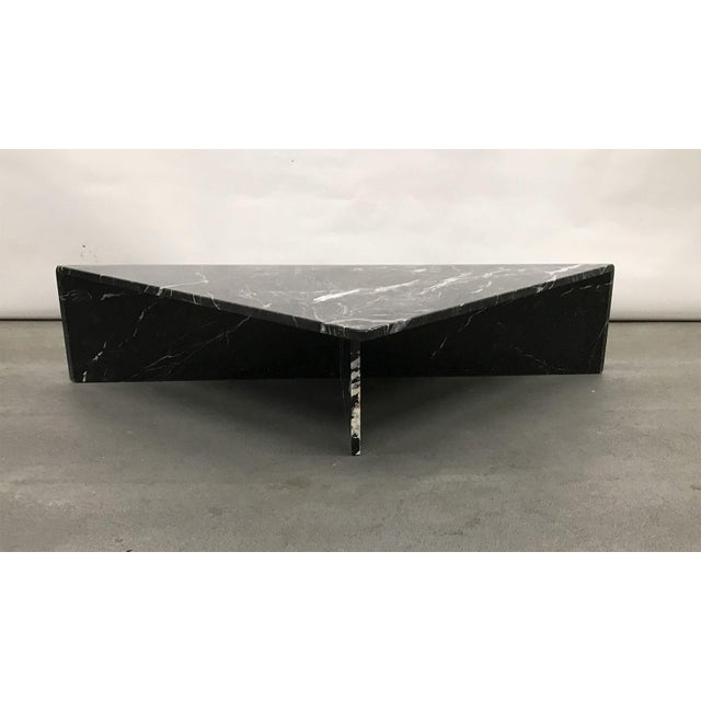 Handsome marble triangular table, circa 1970s. Stone is deepest black with high contrast white veining; finish is glossy...